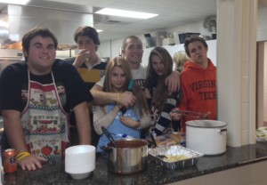 AT BAYSIDE PRESBYTERIAN Church these Cox Students (left to right) Chad Wentz (11), Sam Kennedy (12), Maria Kolesova (10), Chris Ruediger (12), Haley Henahan (10), Will Colthorpe (12), volunteer by serving food to the homeless.