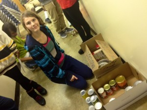 SENIOR OLIVIA TOLLEFSON helps other students in her Leadership class organize Thanksgiving basket items.