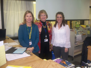 (L-R) LIBRARIANS LISA WILLIAMS, Judy Rea, and Laura Dember pose for the camera.