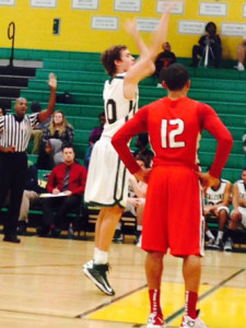 SOPHOMORE COLE JOHNSON goes up for the free throw against Landstown High School.
