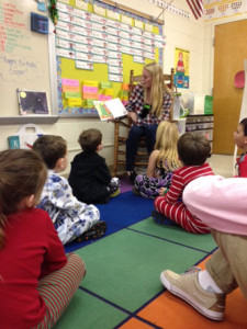 SCA MEMBER SOPHOMORE Riley Weers reads to elementary students at John B. Dey.