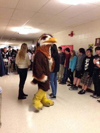 THE SCHOOL MASCOT pumps up the hallways for the winter spirit walk.
