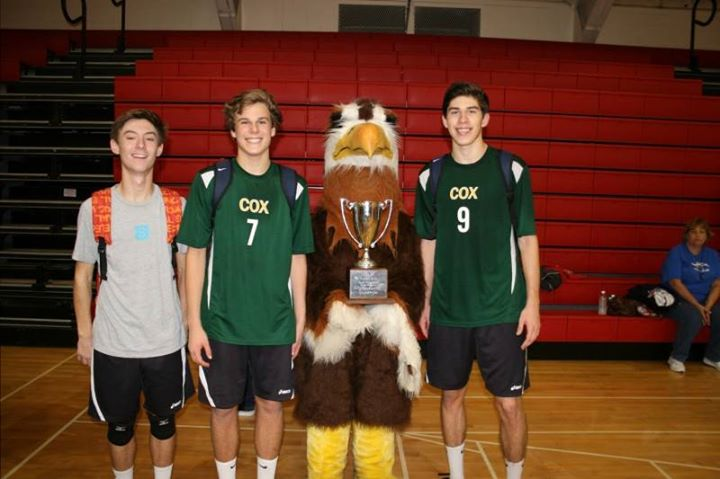 SENIOR+VOLLEYBALL+PLAYERS+Will+Calaman%2C+Russell+Dervay%2C+and+Brett+Rosenmeier+proudly+stand+with+the+school%27s+mascot+and+their+first+place+Regional+trophy.