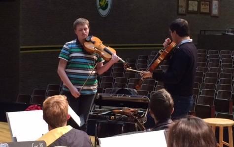 VIOLINIST NICK MCKEE recently took a lesson from East Carolina University music professor Ara Gregorian.
