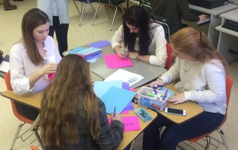 FALCON PRESS JOURNALISTS make teacher appreciation cards.