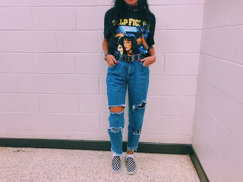 SOPHOMORE DRESSED IN her thrifty outfit; ripped classic blue jeans and a vintage shirt.