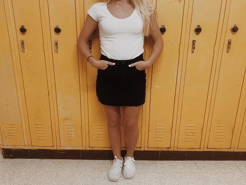 SOPHOMORE REGAN MINYARD wears a black mini skirt with a simple white T.