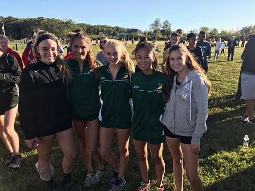 LADY FALCON RUNNERS after the Beach District meet at Kellam High School.  The team placed 2nd in the district with four girls earning all-conference honors.