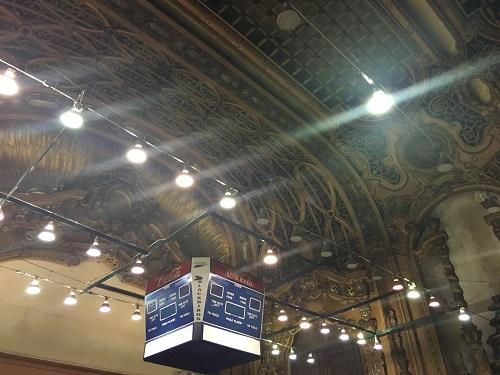 JUNIOR ANNA MASON takes a photo of a basketball scoreboard in New York City.