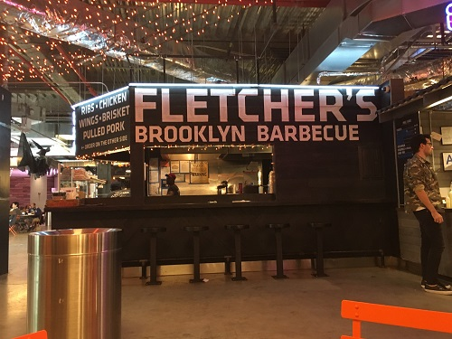 JUNIOR ANNA MASON takes a photo of Fletcher's Brooklyn Barbecue in New York City.