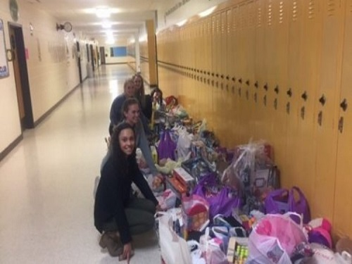 NOBLE TEENS SORT through toys  for local elementary schools.