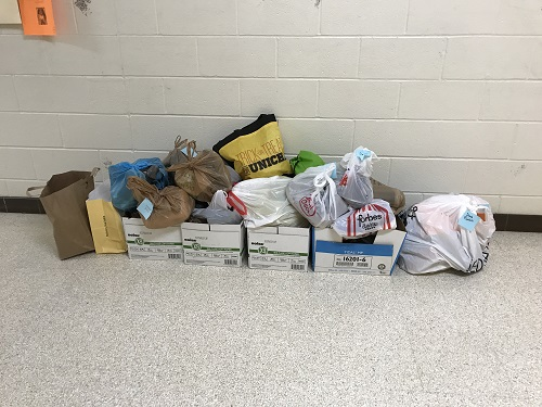 KEY CLUB COLLECTS shoes for homeless and migrant workers outside of room 227.