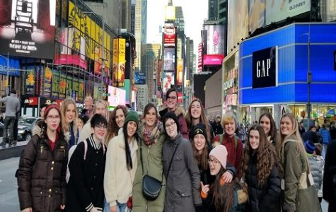 ART STUDENTS STAND in front of the Statue of Liberty while on their trip to New York.