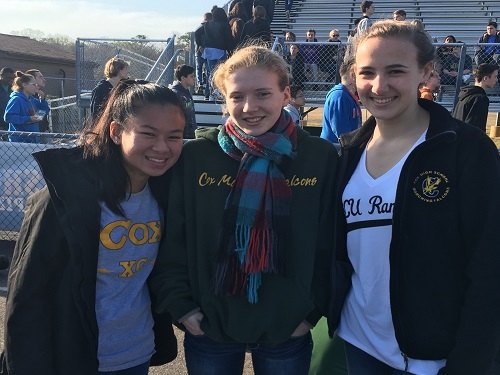 SOPHOMORE BAILEY DEAVER and seniors Lily Roark and Haley Brown represent Cox track at the pep rally.