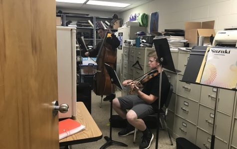 JUNIOR ELI DILLS practices the violin. in preparation for the upcoming orchestra concert.