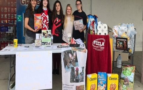 FCCLA ADVISOR RAENA Weimer (left to right) and students Julia Shukis, Ivory Kamzura, Anastasia Owens, and Piper Kamzura collected donations for Wildlife Response Inc. last weekend.