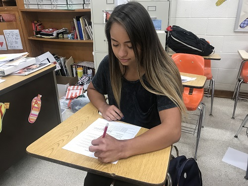 SENIOR LEAH SMITH finishes an assignment during her final week of high school.