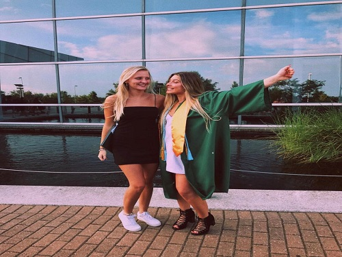 Although she graduated at the end of her junior year, Lauren Hillier celebrates her high school graduation.