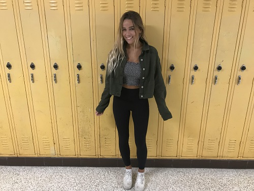 SENIOR TAYLOR TRAFTON wearing a dark green jean jacket with leggings and a striped top.