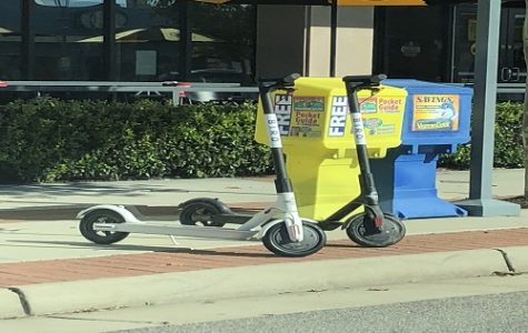 THE BIRD SCOOTERS sit on the side of roads around the city.  These two were dropped off near Buffalo Wild Wings on 31st  Street at the Oceanfront.