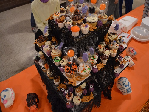 DECORATIVE TREATS SIT on display for families to enjoy at the annual SCA Boo Bash event. Students baked the treats themselves especially for Boo Bash.