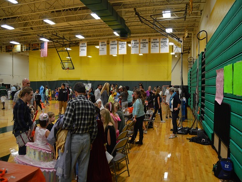 FAMILIES FLOOD THE gym for Boo Bash. Clubs and sports teams set up Halloween games and stations for children.
