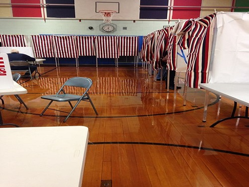 A POLLING STATION is set up in a New Hampshire public school.  Around the country there are polling stations set up in different schools, churches, and other common places for people to cast their votes.