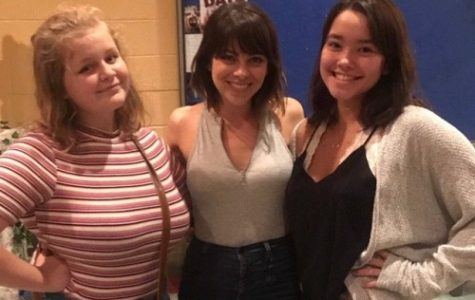 SOPHOMORE SYDNEY STRICKLAND (left) and junior Zoe Ferrell (right), representatives of the school's Fine Arts department, recently participated in a master class at the Little Theatre of Norfolk. Stage and screen actress Krysta Rodriguez (center) also participated in the class.
