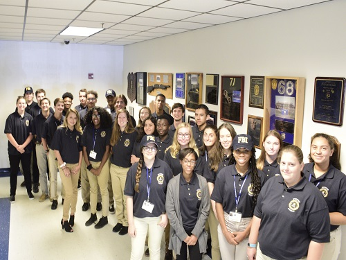 FUTURE FBI AGENT senior Taylor Everett stands with fellow FBI trainees at  the Norfolk Police Station Precinct 19. Everett was accepted into this prestigious week-long program last summer to learn more about the FBI.