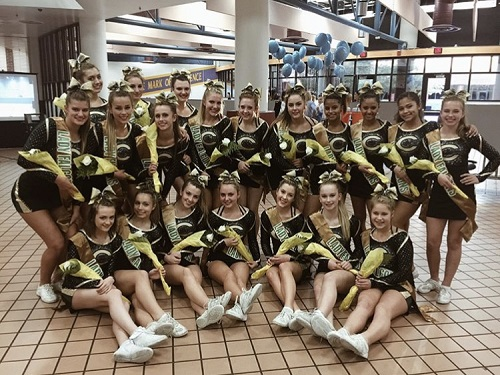 THE CHEERLEADERS SMILE big after placing at their competition. The girls worked hard every week to be prepared for their performance.