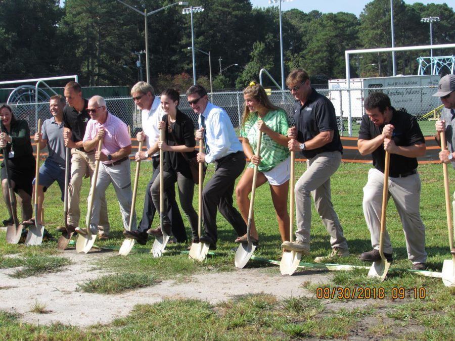 ADMINISTRATION AND SENIOR Abbey Faro were holding shovels.  They are presenting  the new groundbreaking wing.