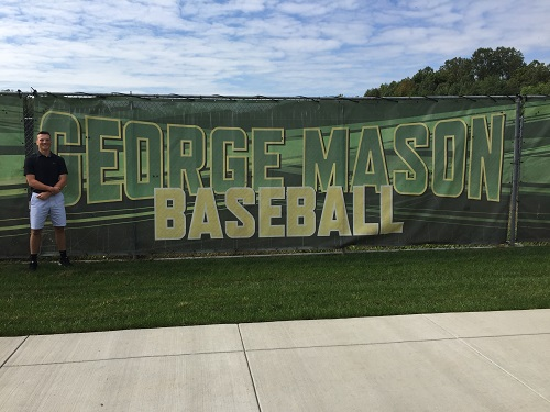 SENIOR SOUTH TRIMBLE stands proudly next to the George Mason University (GMU) baseball field. Trimble committed to play ball at GMU in September.