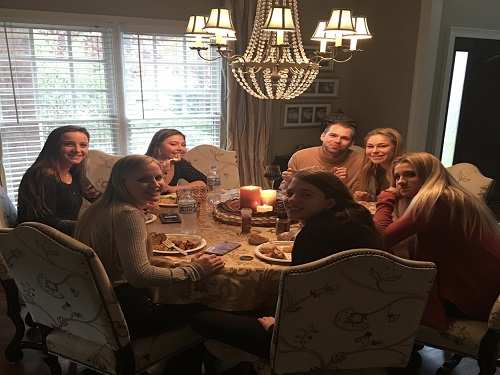 THE HILLIER FAMILY sat around the table while they ate their Thanksgiving dinner.  Their enjoying their family gathering.