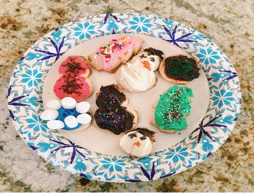HOLIDAY DECORATED COOKIES sit, ready to eat after baking.  Four Lady Falcons decorated different winter designs on the cookies last year in December.