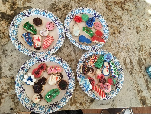 FOUR PLATES FULL of cookies spread out on multiple plates after decorated by a few Lady Falcons.  The cookies were decorated to look like holiday designs.