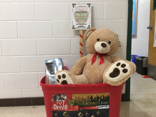THE NOBLE TEENS toy drive box is filled with new, unwrapped toys. The Noblemen provide children toys during the holidays throughout Hampton Roads.