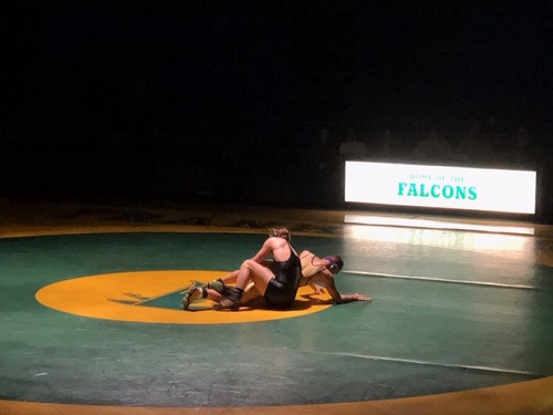 JUNIOR IAN BALIK pushes up from the mat after a strong comeback by the opposing team. The Falcon athlete