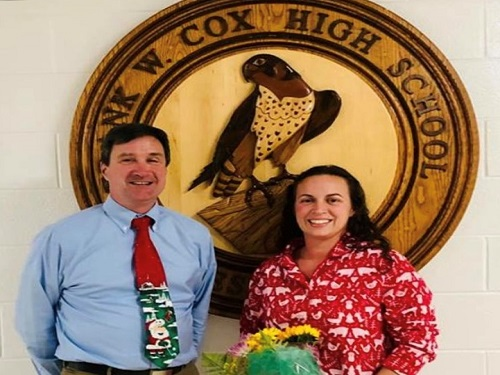 PRINCIPAL DR. MICHAEL Kelly and newest Teacher of the Year Melissa Rusak stop for a quick picture in front of the school's mascot.  Rusak was named as the 2019-2020 'TOY' on Monday afternoon.