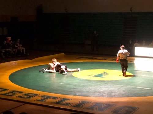 SOPHOMORE WES SCHLEMER wrestles against a Landstown student on Wednesday.  The wrestling team won their home opener against Landstown.