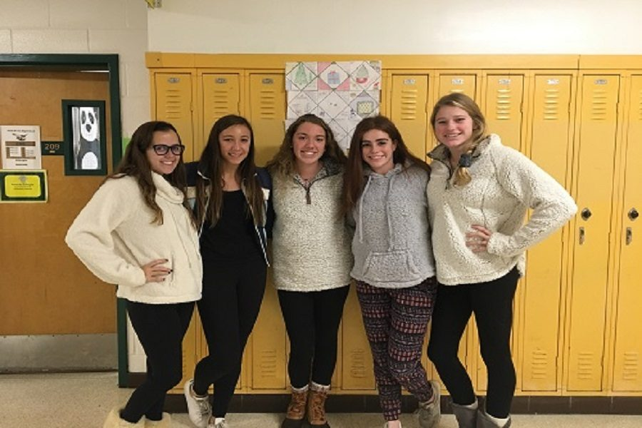 STUDENTS DRESS WARM and cozy for Spirit Week's Ski Lodge Day.  These girls are ready to hit the slopes.