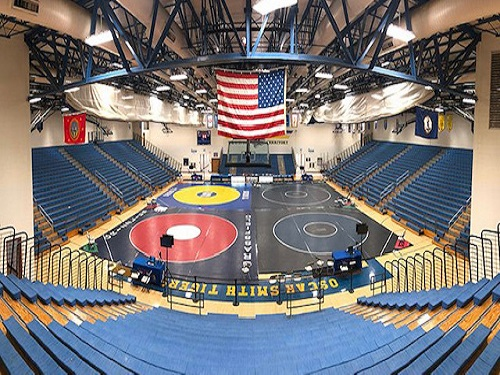 WRESTLING PREPARES TO compete at the Virginia Duals wrestling tournament last year. Several team members placed in the state-wide competition.