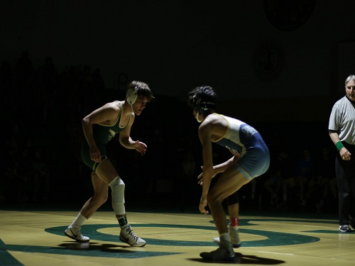 SENIOR WEBB DRESCHER (126lbs.) stands ready to pounce. Drescher was able to score points for the Falcons with his pin.