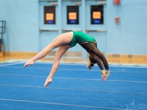 SENIOR CHLOE HULLS competes on the floor. The team has been practicing weekly for their competitions.