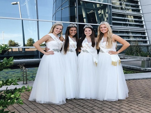 FOUR NEPTUNE PRINCESSES smile for one of many photo ops  as they prepare to head down to the Oceanfront Neptune Festival. These girls will collaborate throughout the year with various organizations to prepare for this event.