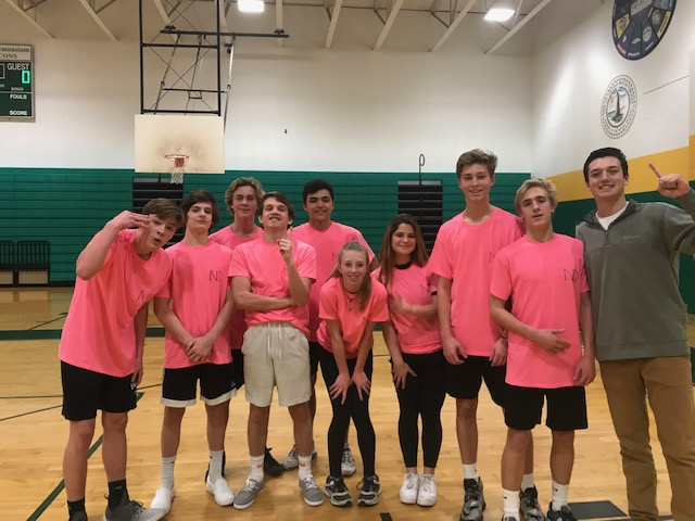 TEAM NARD DOGS win in the first round basketball game during Monday's 'Hoops for Hope' kick-off game. The team fought hard for their win.