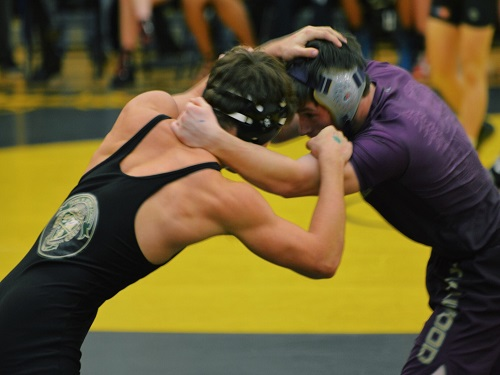 SENIOR DALTON LoALBO (152 lbs.) holds his own against the tough competition. The boys suffered a hard loss against the Tallwood Lions.