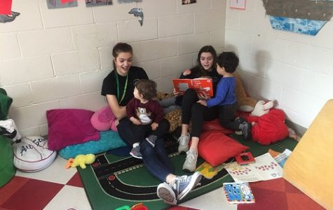JUNIOR VIRGINIA TEACHERS for Tomorrow (VTFT) students Kaitlyn Piston and Sarissa Bryant read to children. The students visited Leaf Spring Preschool on Wednesday, February 13th, to get real world experience of working with children in a classroom setting.