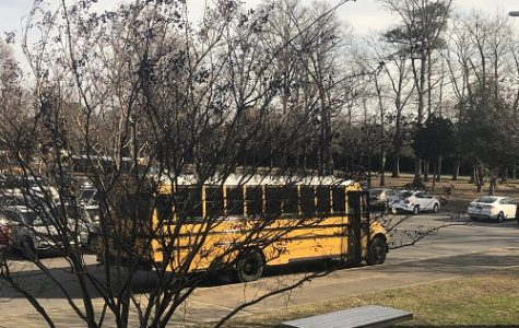A SCHOOL BUS waits to pick up students outside of school at the 2:10 dismissal. The new Here Comes the Bus app now allows parents to track when their students' buses and when it will arrive at their bus stops.
