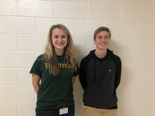 MATH TEACHER MADISON Sandway and junior Eric Michals get together to find out where they will meet on Tuesday March 26. Ms. Sandway followed Eric from when he entered school until he left on March 26.