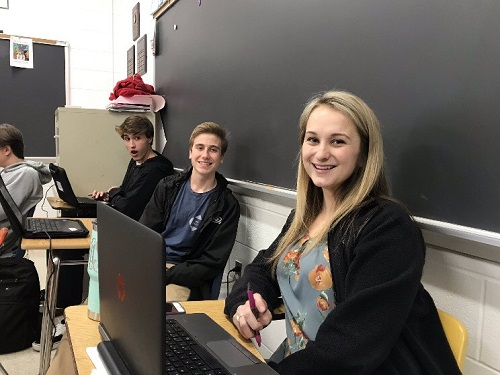 MATH TEACHER MADISON Sandway acts as a student during the Shadow a Student Challenge this week.  Sandway shadowed junior Eric Michals on Tuesday, caught here together in Michal's Honors English class.